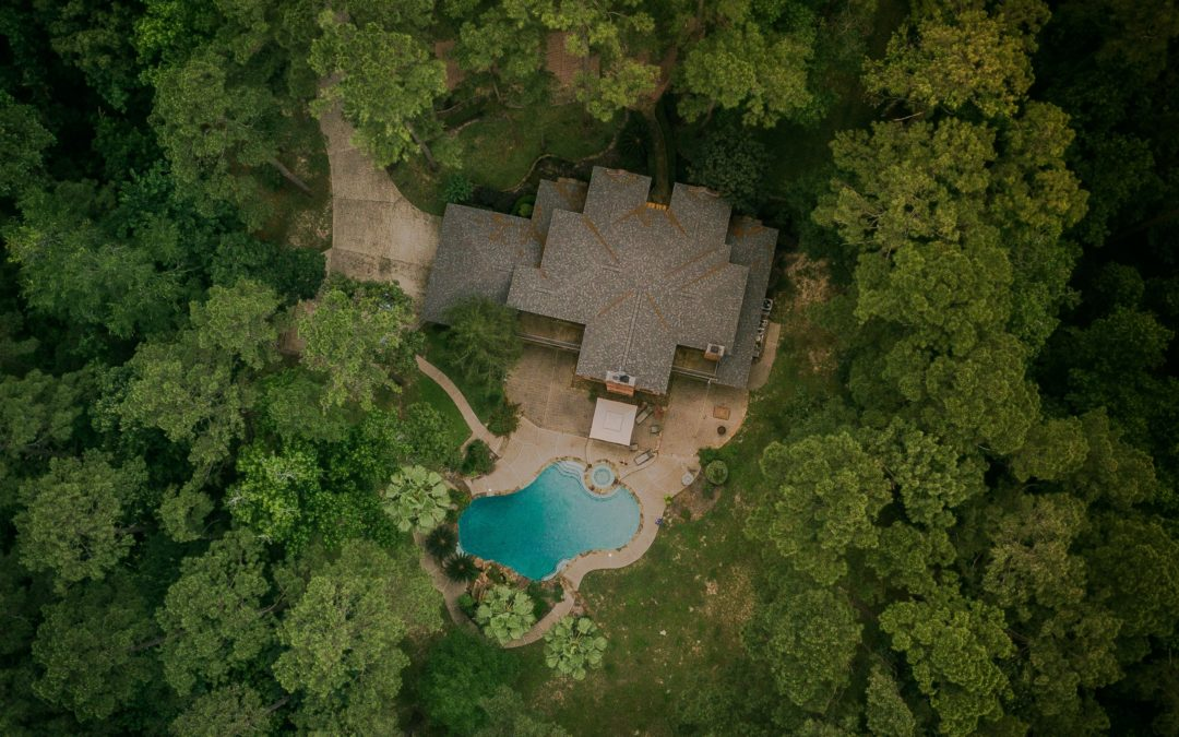 aerial shot house roof in woods